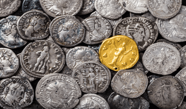 A collection of Roman coins including a gold coin